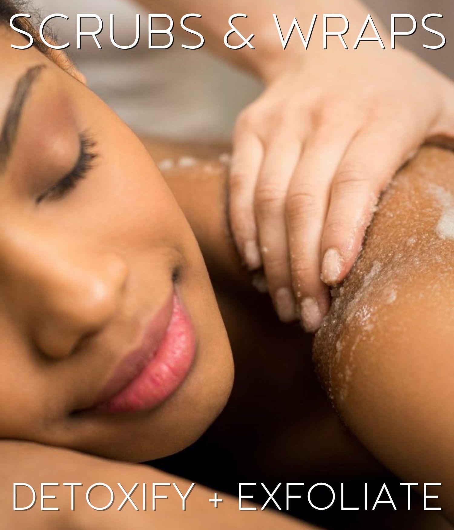 beautiful woman having scrubs and wraps treatment promoting detoxify + exfoliate