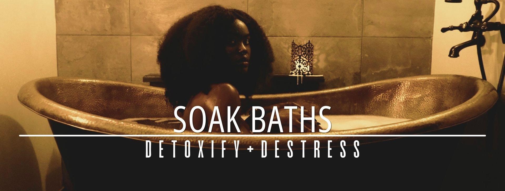 woman in a bathtub having soak baths promoting detoxify + destress